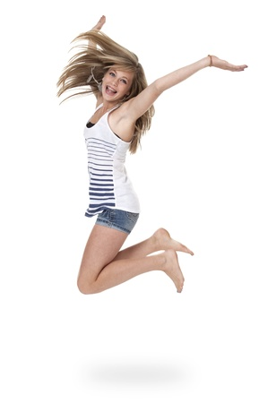 Pretty 14 year old girl jumping mid-air, isolated on white. photo