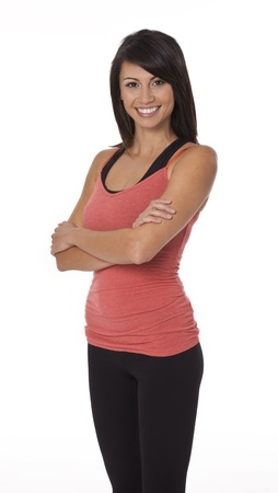 Woman wearing sportswear standing with arms crossed on white background. 版權商用圖片