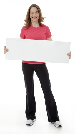 Attractive adult woman standing, holding blank sign, isolated on white. 版權商用圖片
