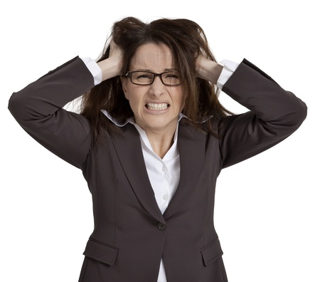 Businesswoman with hands on head and look of frustration, on white background.