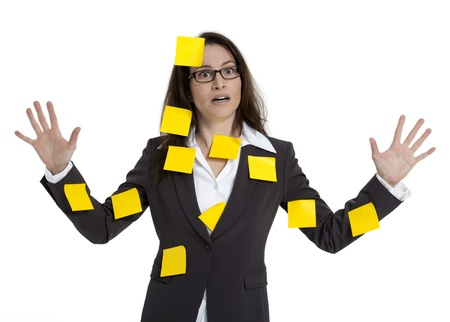 stressed business woman: Stressed out business woman with numerous post-it notes stuck on her. White background. Stock Photo