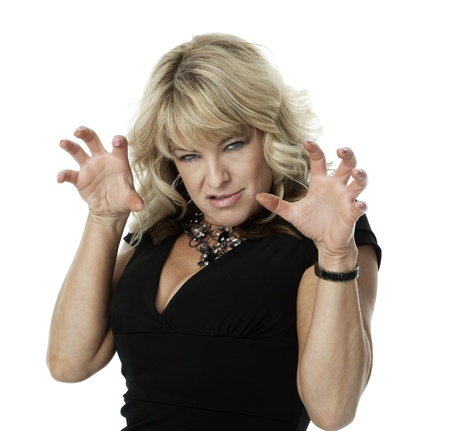 Mid-adult blonde woman with angry expression and hands raised in claw-like gesture, on white background.