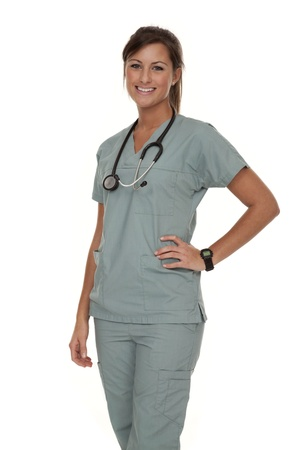 Three quarter view of pretty young nurse wearing green scrubs on white background