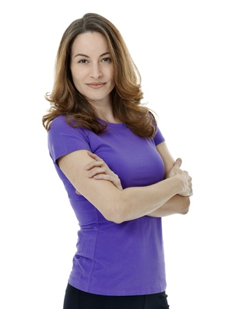 Pretty brunette woman standing with arms crossed on white background.