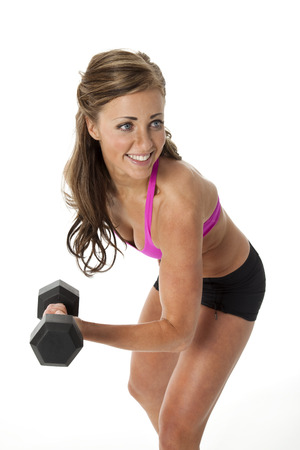 Pretty young woman lifting dumbbells on white background  photo