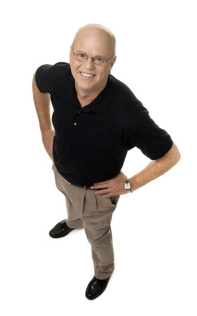 Full length photo of smiling mature man, hands on hips, standing on white background.