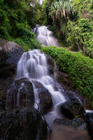Beautiful waterfall in forest, Na Mueang 2 waterfall, Samui island, Suratthani, Thailand