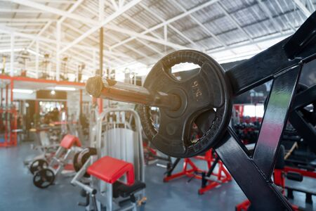 fitness club with equipment, gym for exercise and weight training, body transfomation