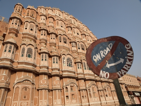 Dirt No Parking sign in front of Hawa Mahal or The Wind Palace,  one of the principal tourist attractions in the Jaipur, Rajasthan, India Stock Photo - 13629343
