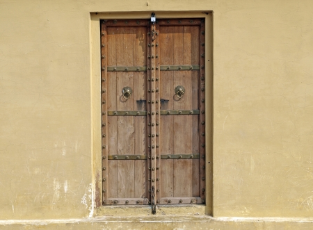 Classic wooden door in Jantar Mantar Astronomical Observatory, Jaipur, India photo