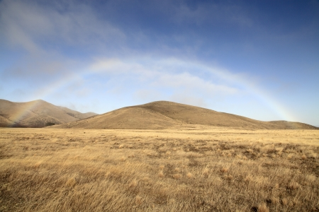 rainbow over the dry grassland at the south island of new zealand Stock Photo - 13873812