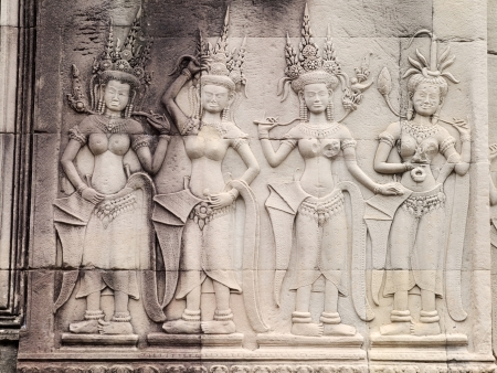 Details of Apsara carving on the wall of Angkor Wat, Cambodia photo