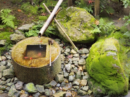 Japanese style traditional bamboo fountain at Ryoan-ji temple, Kyoto, Japan photo