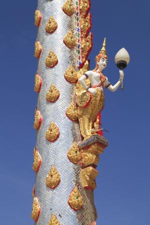 Thailand mythical female bird with human head hold the lantern photo