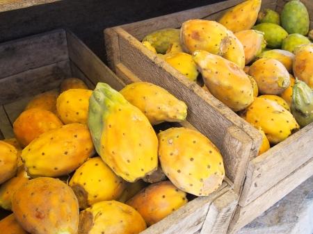 Cactus fruit in crate in Peru market Stock Photo