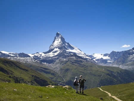2 hiker on the hiking trail around Mt.Matterhorn, Switzerland photo