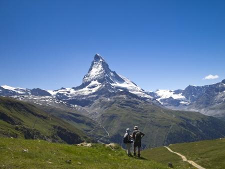 2 hiker on the hiking trail around Mt.Matterhorn, Switzerland