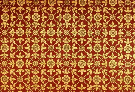 Pattern of Thai classical painted golden flower and leaves on the temple's ceiling