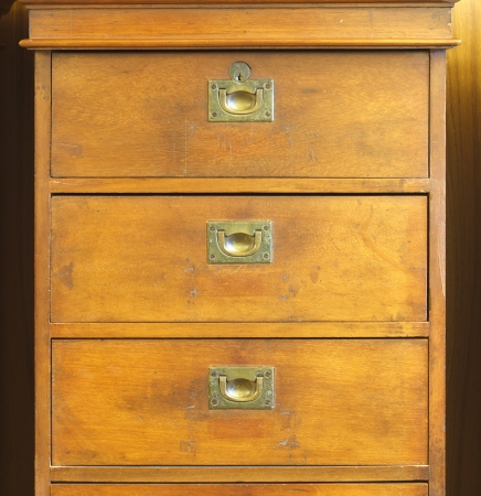 Old wooden chest of drawers photo