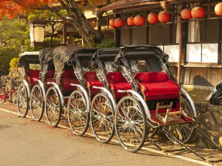 Group of rickshaws in Arashiyama area, Kyoto, Japan. Editoriali