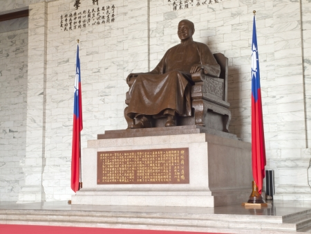TAIPEI, TAIWAN - APRIL 29: A large bronze statue of Chiang Kai-shek on April 29, 2010 in Taipei, Taiwan. This huge bronze statue is shown smiling, seated and wearing traditional Chinese dress of Chiang Kai-shek dominates the main hall of the CKS memorial
