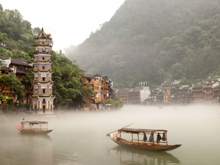 huang: HUNAN, CHINA - JULY 7: View of Tuojiang River on July 7, 2010 in Fenghuang county, China. The ancient town of Fenghuang was added to the UNESCO World Heritage Tentative List in the Cultural category.