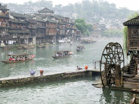 tentative: HUNAN, CHINA - JULY 7: View of Tuojiang River on July 7, 2010 in Fenghuang county, China. The ancient town of Fenghuang was added to the UNESCO World Heritage Tentative List in the Cultural category.