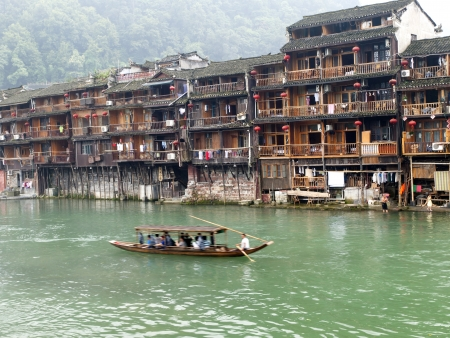 tentative: HUNAN, CHINA - JULY 7: Old houses in Fenghuang county on July 7, 2010 in Hunan, China. The ancient town of Fenghuang was added to the UNESCO World Heritage Tentative List on March 28, 2008 in the Cultural category.