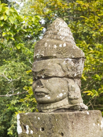 The ancient stone statue of Khmer god on the south gate of Angkor Thom, the world heritage site in Siem Reap province, Cambodia Stock Photo - 17593956