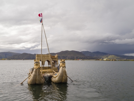 Old traditional floating reed boat in Titicaca lake, Puno, Peru  photo