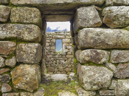 Doorway and window of the Inca sun temple at the lost city of Machu Picchu, Machupicchu District, Urubamba Province, Cusco Region, Peru  photo