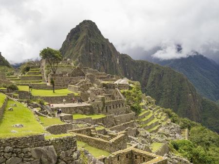MACHU PICCHU, CUSCO, PERU - MAR 15  Tourists visit the Main Square in a pre-Columbian 15th-century Inca site of Machu Picchu after rain on Mar 15, 2011 in Cusco region, Peru