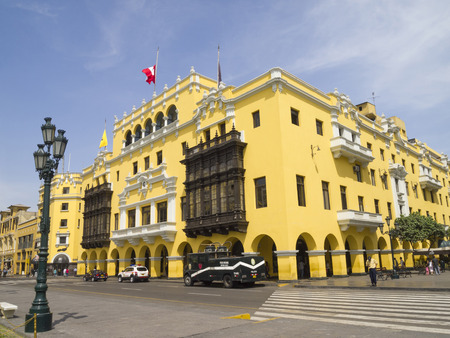LIMA, PERU - MARCH 18  Colonial yellow building at Plaza Mayor  formerly, Plaza de Armas  on March 18, 2011 in Lima, Peru   This plaza has been the center of Lima since the city was founded in 1535