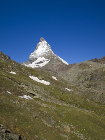 Matterhorn mountain in the Pennine Alps on the border between Switzerland and Italy  Its summit is 4,478 metres  14,692 ft  high, making it one of the highest peaks in the Alps