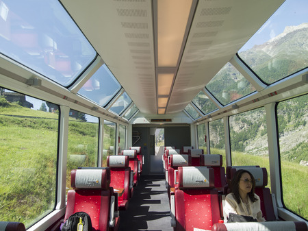 SWITZERLAND - JUN 28  Interior of Glacier Express train on June 28, 2011 in Switzerland  This train travels from Zermatt to Davos or St  Moritz  and being the slowest express train in the world