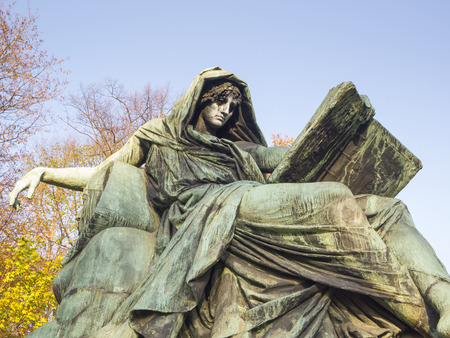sibyl: BERLIN, GERMANY -NOV 12: Statue of sibyl reclining on a sphinx and reading the book of history on November 12, 2011 in Berlin, Germany. This statue located in the Bismarck Memorial in Tiergarten.