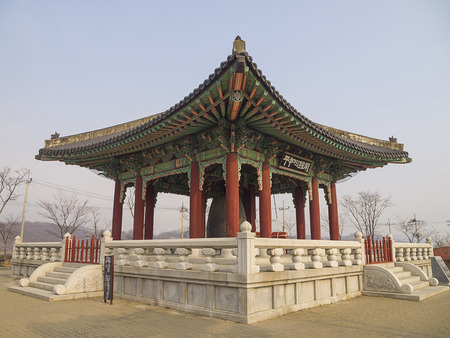 demarcation: PAJU, SOUTH KOREA - MAR 27: The Peace Bell Pavilion on Mar 27, 2012 in Imjingak, Paju, South Korea. This pavilion located on the point that marks the division of North and South Korea.