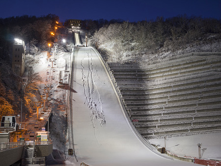 SAPPORO, JAPAN - DEC 12: Okurayama Ski Jump Stadium at night on December 12, 2011 in Sapporo, Japan. This stadium has hosted a number of winter sports events including 1972 Winter Olympics.