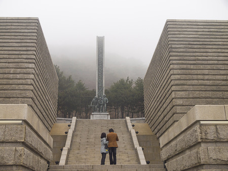 upholding: INCHEON, SOUTH KOREA-MAR 30: Visitors walking to the statue of upholding liberty in Incheon Landing Operation Memorial Hall on Mar 30, 2012 in Incheon, South Korea. Editorial