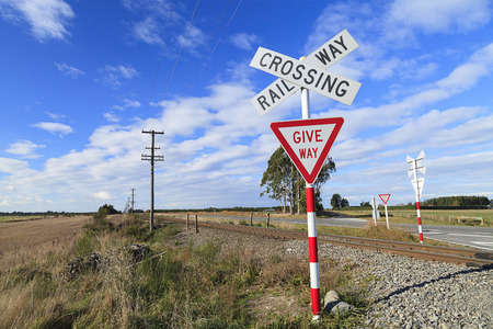 rail cross: Railway crossing and give way sign, New Zealand.