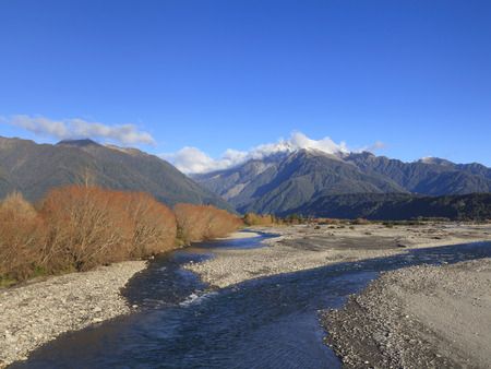 west river: Poerua River and the Southern Alps, West Coast, South Island, New Zealand. Stock Photo