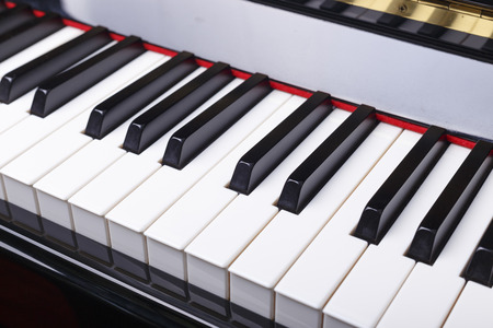 Close up of Piano keys, selective focus with shallow depth of field. photo
