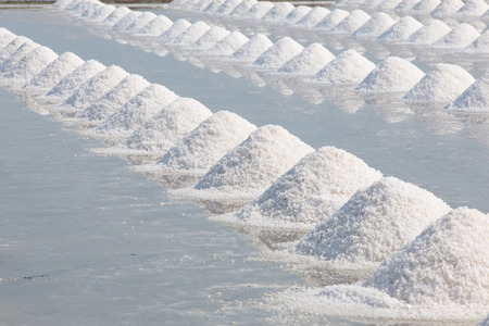 Heap of sea salt in salt farm ready for harvest,  Thailand.