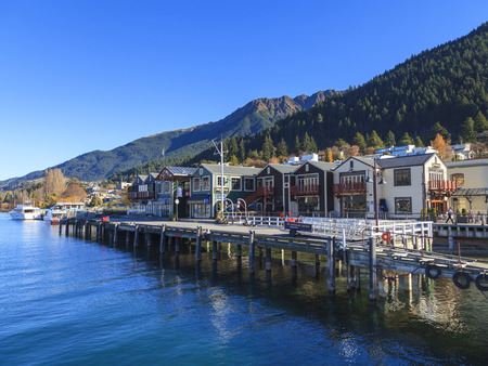 renowned: QUEENSTOWN, NEW ZEALAND -MAY 22: Queenstown waterfront on May 22, 2012 in Queenstown, NZ. Queenstown is a world renowned travel destination attracting around 1.9 million visitors every year.