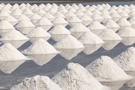 salt water: Heap of sea salt in salt farm ready for harvest,  Thailand.