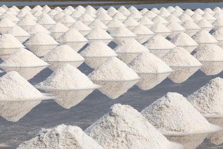 Heap of sea salt in salt farm ready for harvest,  Thailand.