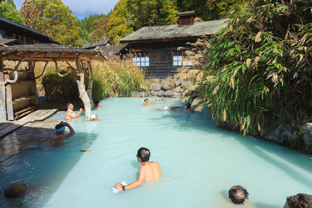 AKITA, JAPAN -OCT 20, 2012: People soaking in outdoor hot spring pool at Tsurunoyu onsen. Tsurunoyu Onsen is one of the oldest hot spring resorts of Nyutou Onsenkyo with a history of over 300 years