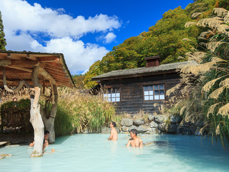 steam bath: AKITA, JAPAN -OCT 20, 2012: People soaking in outdoor hot spring pool at Tsurunoyu onsen. Tsurunoyu Onsen is one of the oldest hot spring resorts of Nyutou Onsenkyo with a history of over 300 years