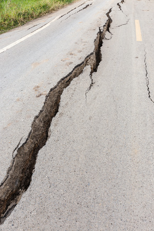 earthquake crack: Cracked and broken asphalt road from earthquake.