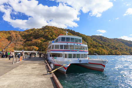 honshu: AOMORI, JAPAN -OCT 24, 2012: Sightseeing boat service at Lake Towada Towadako, Aomori, Japan. This is the largest caldera lake on Honshu island, the best way to see the lake is by sightseeing boats.